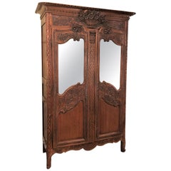 Antique French Carved Elm Armoire with Beveled MIrror Doors