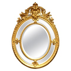 Antique French Carved Gilt Wood Oval Mirror with Beveling, circa 1870-1890