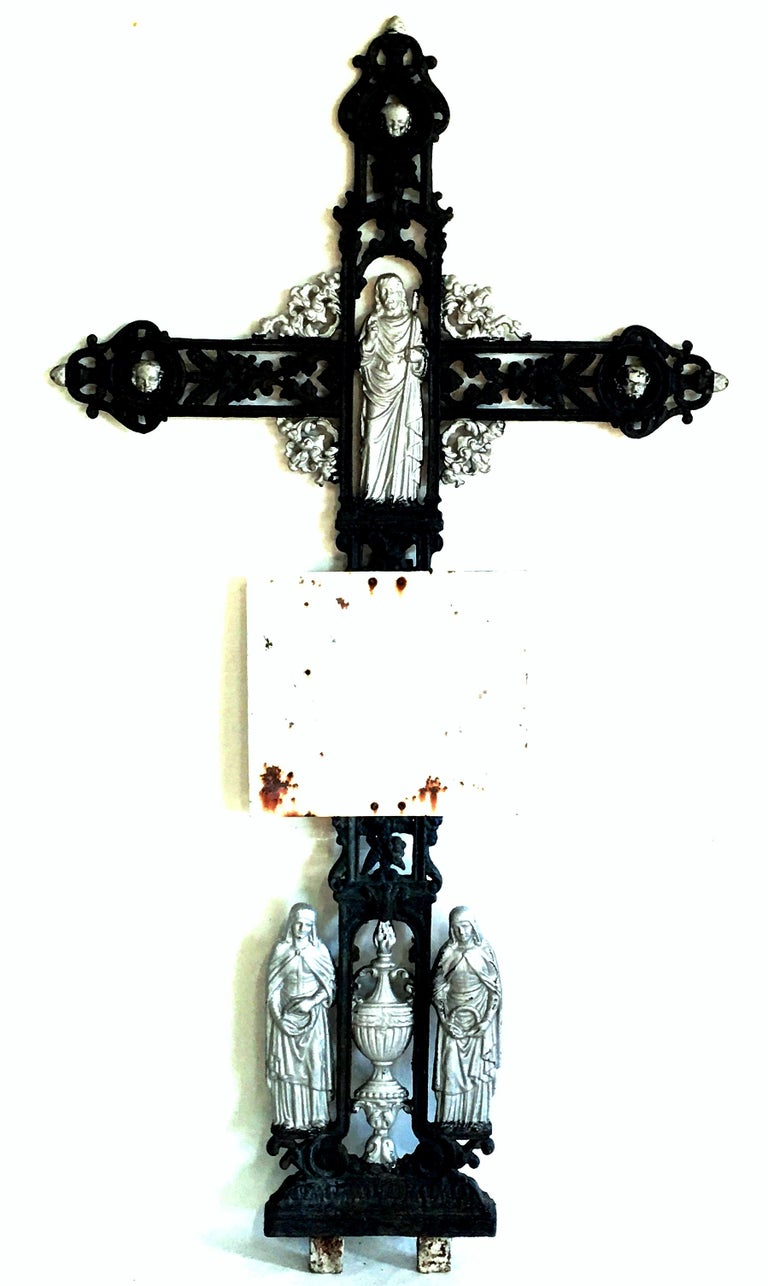 Antique French Painted Cast Iron Black & Silver Louis XVI Style Grave Marker-Crucifix. Features amazing high relief detail on both sides and is accented with silver leaf detail. Depicting Jesus as a Shepard Louis XVI design elements. Mask faces