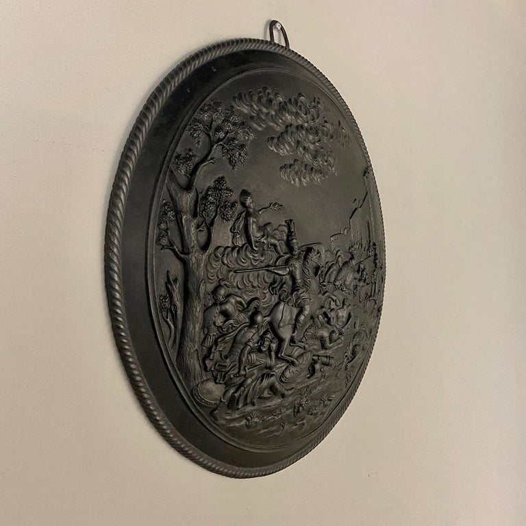 Antique French cast iron wall plaque is perfect for the masculine decor, and simultaneously depicts the chaos of battle while Victory rides in with flowing ribbons atop billowing clouds offering the olive branch of peace. The main scene takes place
