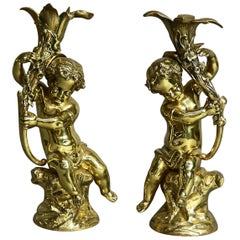 Antique French Classical Gilt Bronze Figural Cherub & Lily Candlesticks