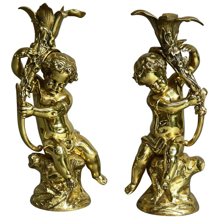 Antique French Classical Gilt Bronze Figural Cherub & Lily Candlesticks For Sale