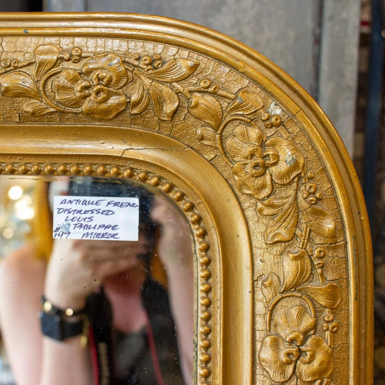 Early 20th Century Antique French Distressed Gold Louis Philippe Mirror with Floral Details For Sale