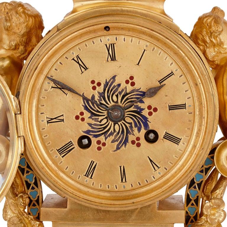 Belle Époque Antique French Eclectic Style Enamel and Gilt Bronze Clock Set For Sale