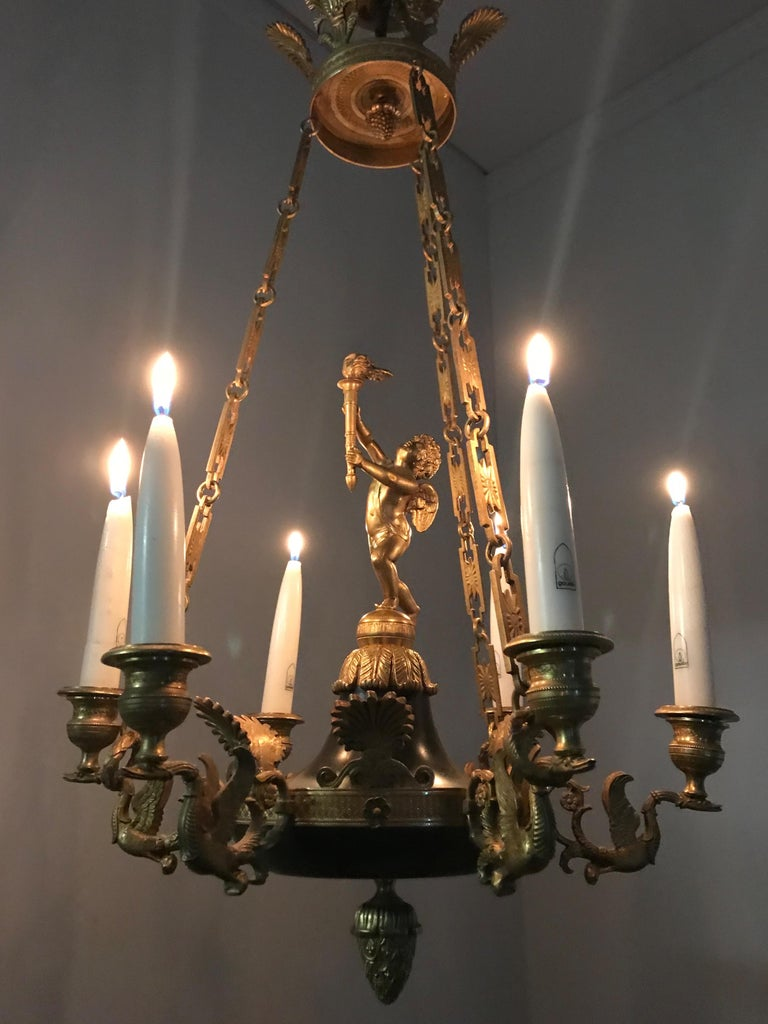 Stunning and small six-light chandelier with gilt bronze cherub and swan sculptures.   This top quality made, 19th century candle pendant or small chandelier could be perfect for you. Both on and off this quality antique can create just the right