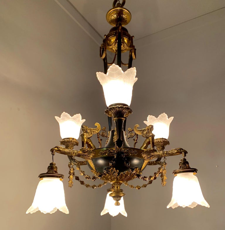 Stunning and large six-light chandelier with glass shades.  This top quality pendant light from the early 1900s is another one of our recent great finds. Both with the light switched on and off this quality antique can create just the right