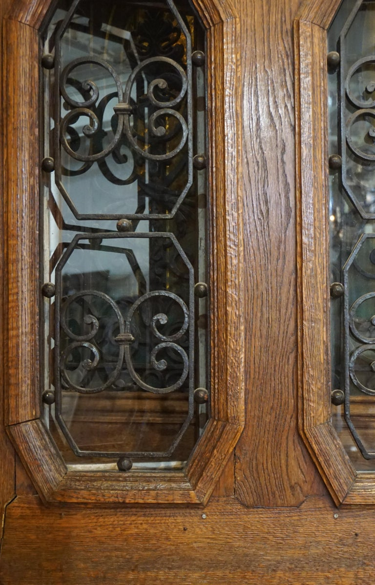 This oak entry door with twin windows and octagonal inset ironwork originates from France, circa 1890.