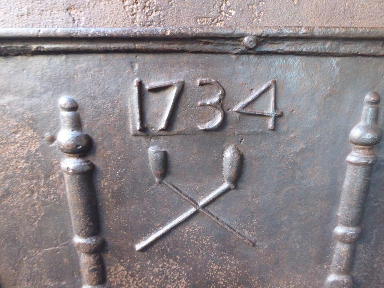 Cast Antique French Fireback with Pillars and Pipes, Dated 1734 For Sale