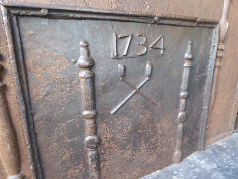 Iron Antique French Fireback with Pillars and Pipes, Dated 1734 For Sale