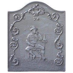 Antique French Fireback with Smoking Man, 19th Century