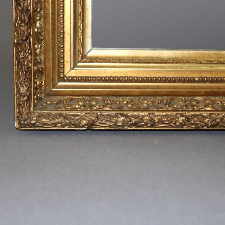 Antique French First Finish Foliate and Floral Giltwood Framed Wall Mirror In Good Condition For Sale In Big Flats, NY