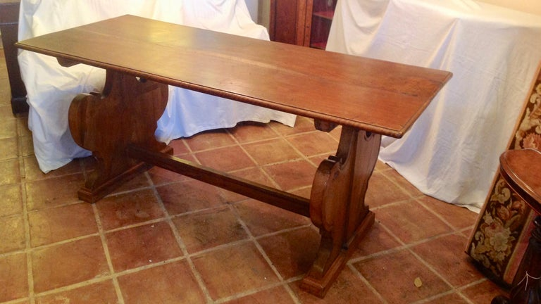 This is a very nice French antique fruitwood refectory kitchen table in very good condition with the original patina .The table is fashioned with stylish and impressive heart shaped ends, circa 1850.