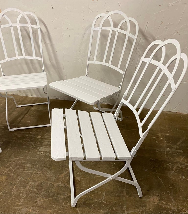Say it with style with this set of 4 antique French folding bistro style dining chairs. Leave them out or fold them up to save space. Great dining chairs for the porch, garden or patio.