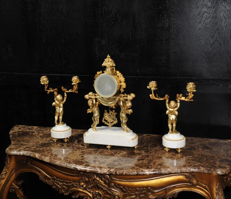 Antique French Gilt Bronze and Marble Cherub Clock Set with Visible Pendulum For Sale 7