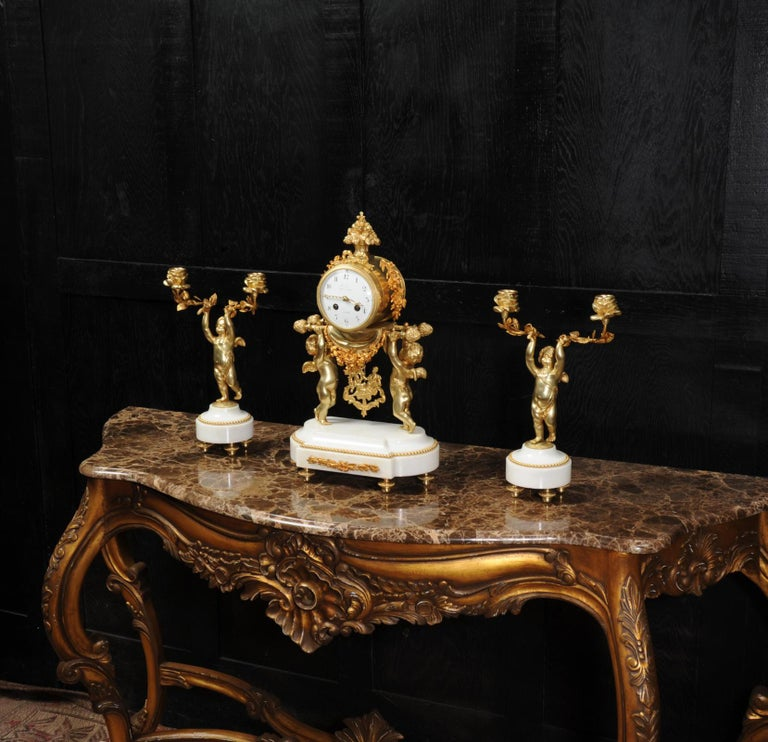 Louis XVI Antique French Gilt Bronze and Marble Cherub Clock Set with Visible Pendulum For Sale