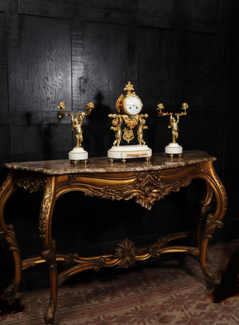 Antique French Gilt Bronze and Marble Cherub Clock Set with Visible Pendulum In Good Condition For Sale In Belper, Derbyshire