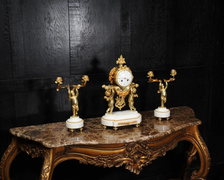 19th Century Antique French Gilt Bronze and Marble Cherub Clock Set with Visible Pendulum For Sale