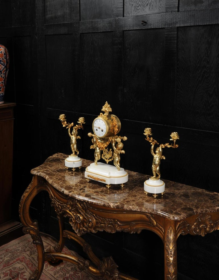 Antique French Gilt Bronze and Marble Cherub Clock Set with Visible Pendulum For Sale 1
