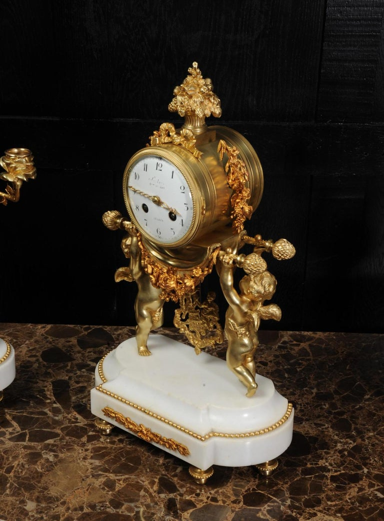 Antique French Gilt Bronze and Marble Cherub Clock Set with Visible Pendulum For Sale 2