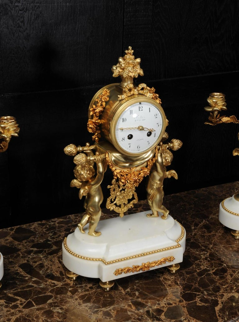 Antique French Gilt Bronze and Marble Cherub Clock Set with Visible Pendulum For Sale 4