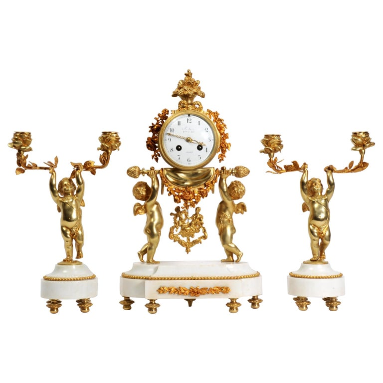 Antique French Gilt Bronze and Marble Cherub Clock Set with Visible Pendulum For Sale