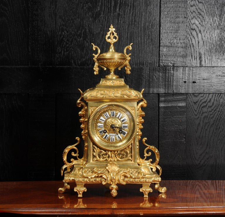 A beautiful original antique French clock, dating from circa 1870. It is in the Louis XVI style, elegantly decorated with acanthus and a large urn to the top. To the front is a panel with blind fret work of acanthus. The rear door is glazed to allow
