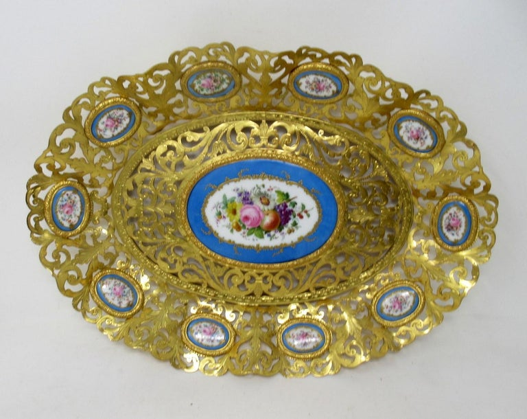 Stunning French gilt bronze table centerpiece or ladies dresser tray decorated with Sèvres soft paste porcelain hand painted inset medallions of outstanding quality, made during the last half of the 19th century  The main tray frame with a wide