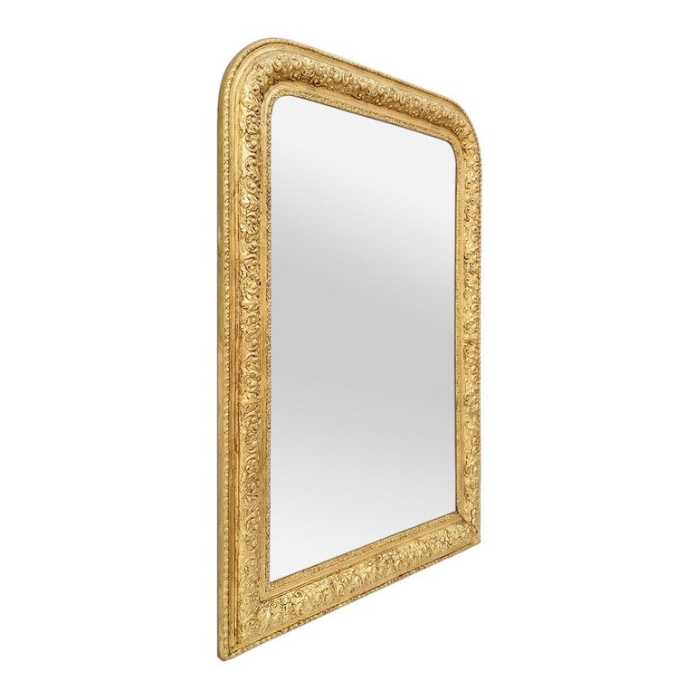 Antique giltwood mirror, Louis-Philippe French style, circa 1900. Antique frame mirror with foliage's decor, re-gilding to the leaf patinated. Modern glass mirror. Antique frame width 9.5 cm / 3.74 in.