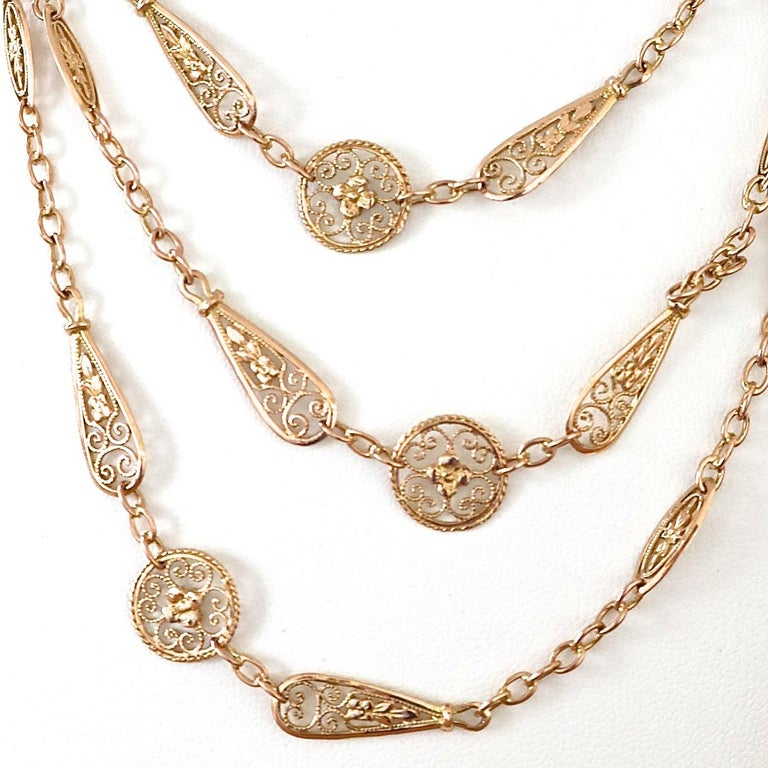 Luxurious Antique French 18k gold necklace with unique chain links and ornamental round and tapered stations. The length is 46 inches and is great for layering or as a stand alone adornment.