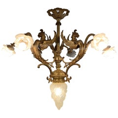 Majestic French Gothic Revival Gilt Bronze Chandelier, Winged Griffin Sculptures