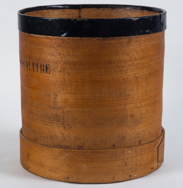 Antique French grain measure, early 20th century. Marked 'Decalitre'. Aged wood with top metal band. Staved wood base.