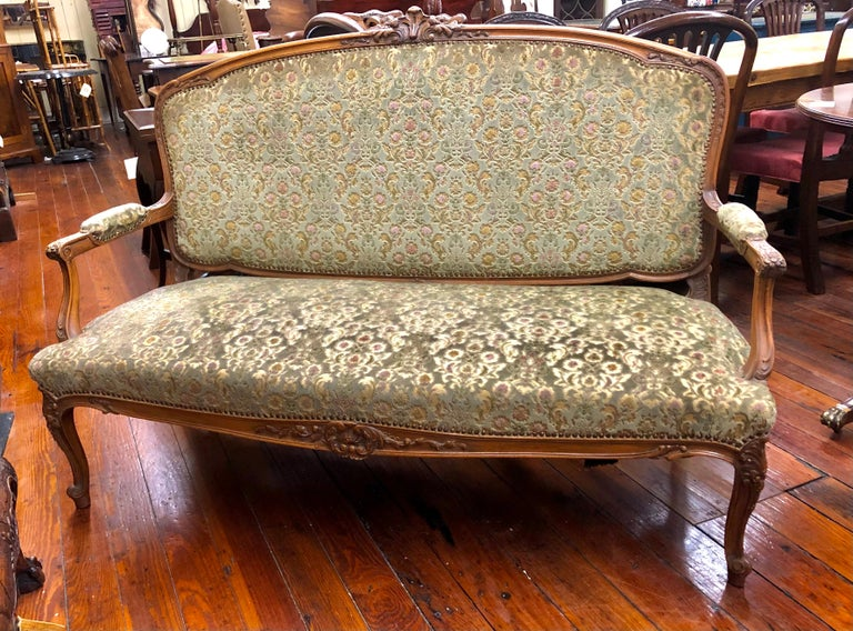 Gorgeous Antique French crisply hand carved fruitwood Louis XV style sofa or loveseat with gorgeous cut velvet in jewel tones. Superb condition.