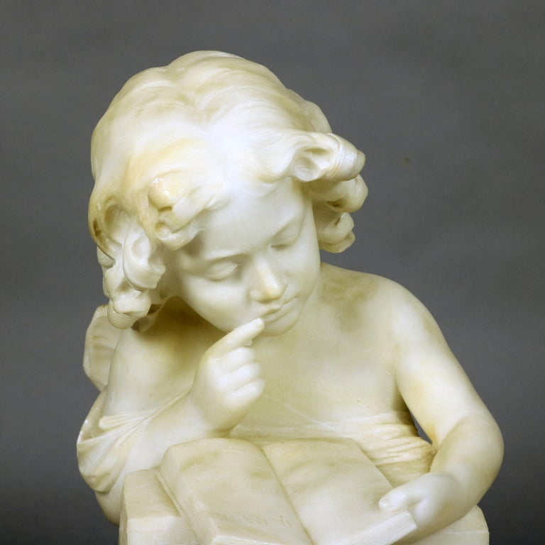 An antique French Volterra Alabaster portrait sculpture depicts young girl with book, raised on circular plinth, en verso artist signed as photographed, circa 1890
