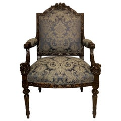 Antique French Intricately Carved Armchair, Fine Blue Upholstery circa 1890-1900