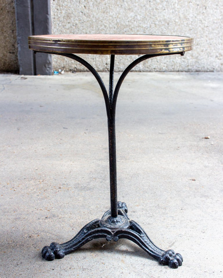 Antique French Iron Bistro Table with Distressed Leather Top In Fair Condition For Sale In Houston, TX