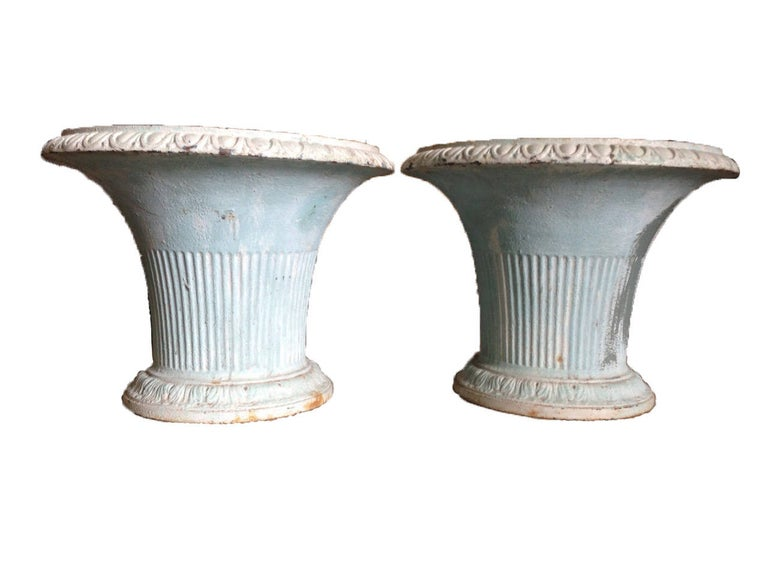 Pair of 19th century French iron jardinières with stunning blue patina. One jardinière has a stain on one side consistent with exterior use.
