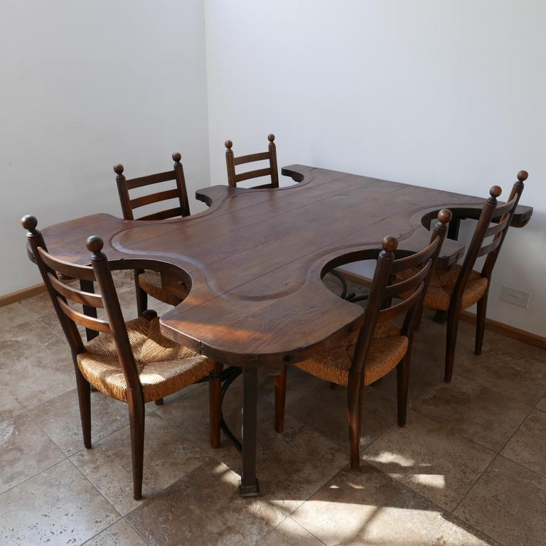 A rare immense quality antique table originally used for jewelry making.  Now the most amazing and unusual dining or work table.  On the original metal base, the old gas taps used for heating equipment remains under the base providing a great
