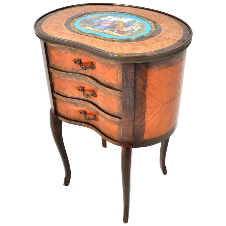 A very fine antique French Louis XV style inlaid 'kidney' shaped side table or chest, inlaid walnut with a large Sevres style plaque depicting lovers in 18th century dress, circa 1880. The top is inlaid with a large enameled 'Bleu Celeste' Sevres