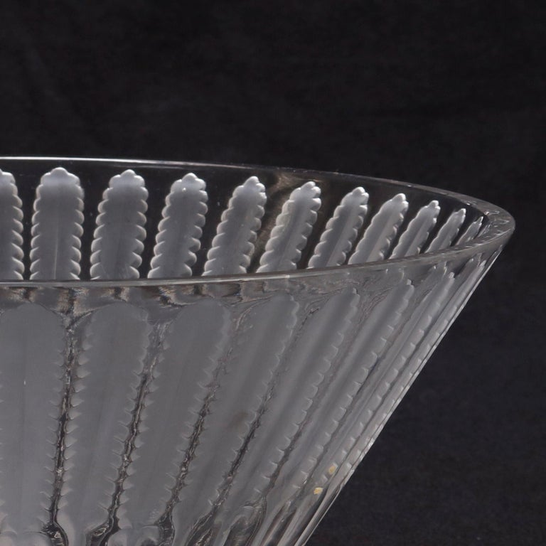 An antique French crystal center bowl by Lalique offers flared form with repeating pattern of low relief frosted foliate elements, circa 1920.  ***DELIVERY NOTICE – Due to COVID-19 we are employing NO-CONTACT PRACTICES in the transfer of purchased