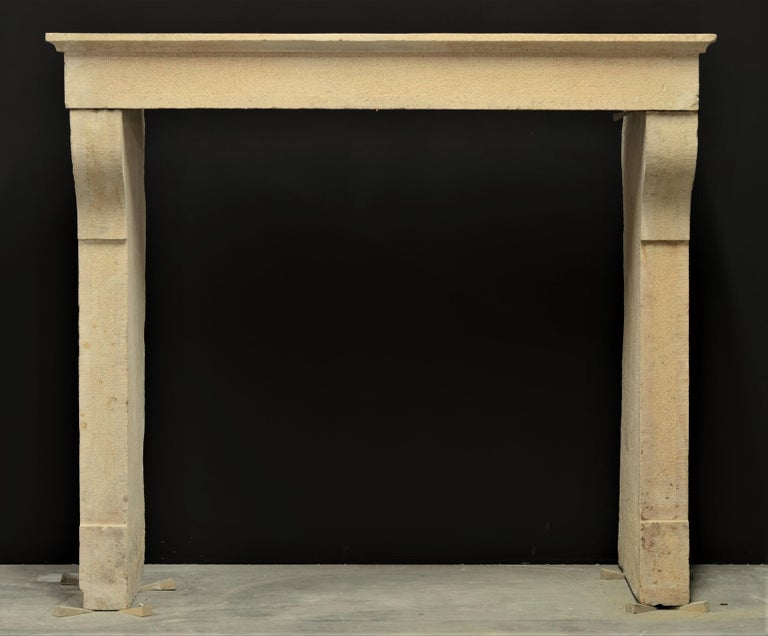 Solid, elegant Burgundy limestone French antique fireplace, 19th century.  The dimensions of the opening are: 101 x 101 cm. or 39.76 x 39.76 inch.  The measurements of the supports are 101 x 10 x 47 cm. or 39.76 x 3.94 x 18.5 inch ( height x width x
