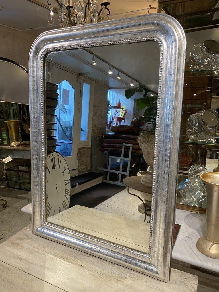 Beautiful antique French Louis Phillipe silver mirror from the 1860s. Louis Phillipe mirrors are characterized by their curvaceous wide frames with rounded corners and wonderfully elegant profiles. Often used on mantlepieces.  This piece still