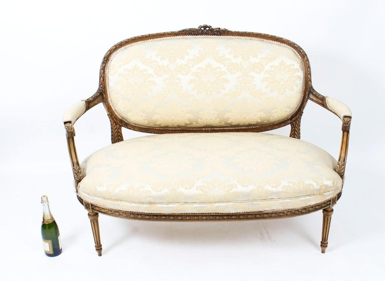 This is a beautiful antique French Louis XVI Revival five-piece salon suite, comprising a sofa and four armchairs, circa 1860 in date.