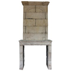 Antique French Louis XIV Limestone Trumeau Fireplace