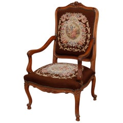 Antique French Louis XV Carved Fruitwood and Pictorial Needlepoint Fauteuil