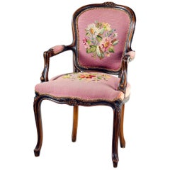 French Louis XV Carved Walnut and Floral Needlepoint Armchair, 20th Century