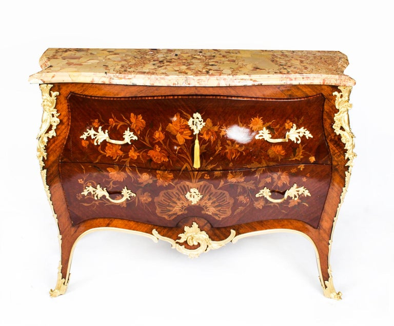 This is a beautiful antique French Louis XV Revival walnut and marquetry commode, circa 1860 in date.   It has a stunning shaped Italian Breccia marble top above two drawers finely inlaid with scrolling foliate and floral marquetry and featuring