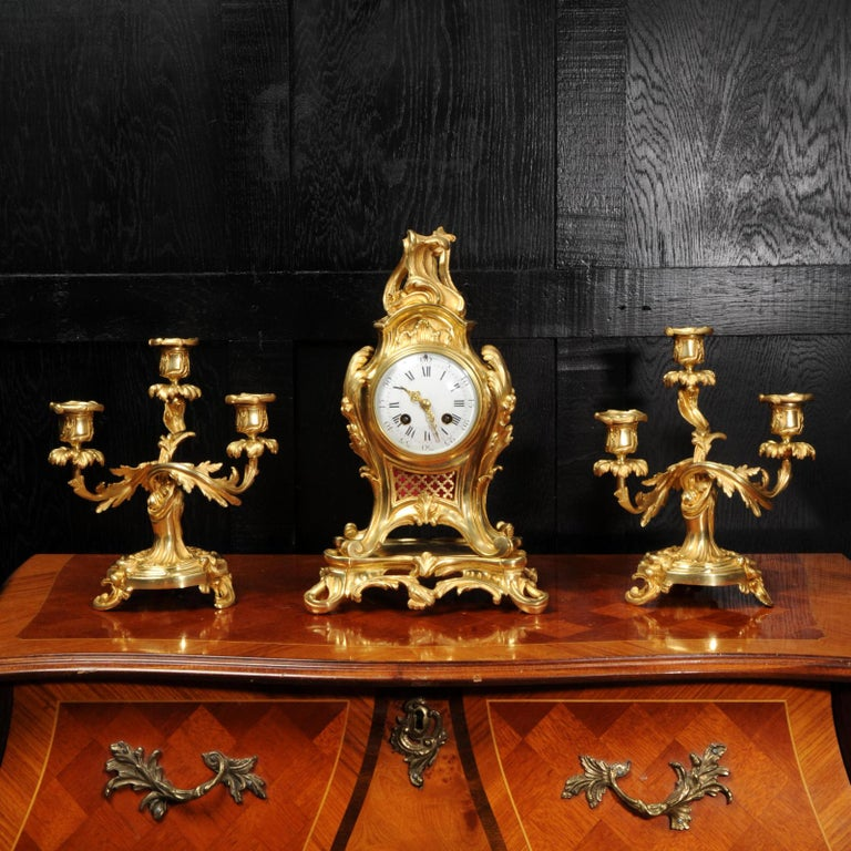 A very fine ormolu Rococo clock set by Charles Hour, circa 1880. It is beautifully modelled in the Rococo style of Louis XV in Ormolu (finely gilded bronze). Beautiful balloon shaped case with acanthus to the shoulders and a Rococo flourish to the