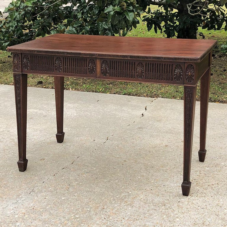 Antique French Louis XVI mahogany console or writing table represents the combination of extraordinarily talented furniture craftsmanship with one of the finest wood types known in the furniture world. Mahogany has been prized for centuries for its