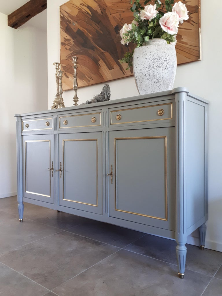 Antique French Louis XVI style buffet, fluted legs finished with golden bronze clogs. Three dovetailed drawers and doors with brass details and keys. Inside each compartment has a shelf for a large storage capacity.