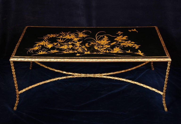 A unique antique French Louis XVI style rectangular black gilt decorated lacquered top gilt bronze coffee table of great detail hand-painted in gilt depicting birds and flowers attributed to Maison Bagues, Paris.